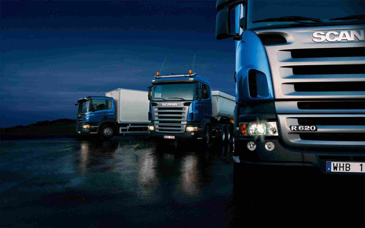 Three-trucks-on-blue-background