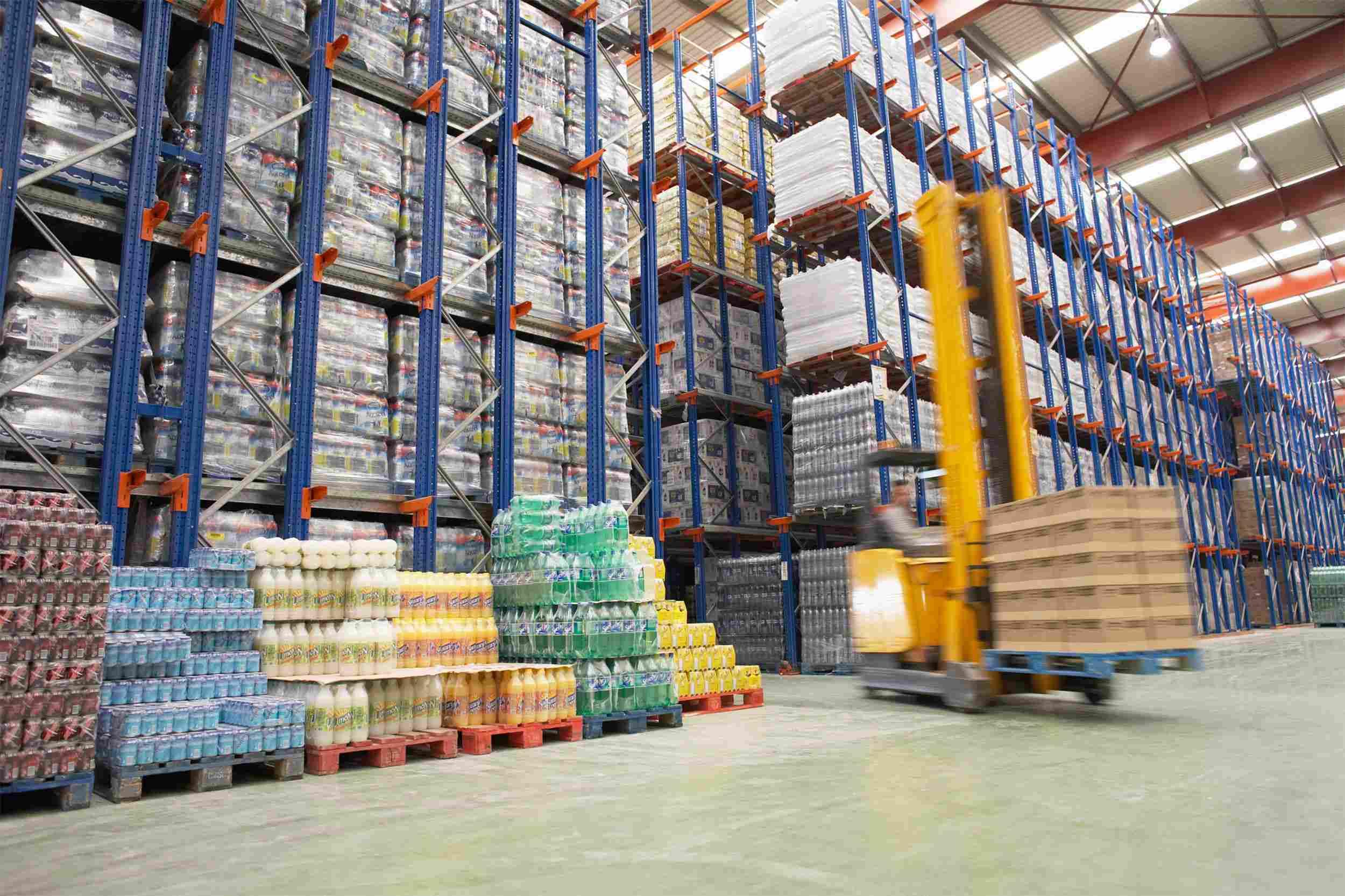 https://www.astellogistic.com/wp-content/uploads/2015/09/Warehouse-and-lifter.jpg